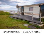 holiday park cabin on the west... | Shutterstock . vector #1087747853