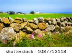stone fence in summer... | Shutterstock . vector #1087753118