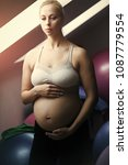 Small photo of Woman touching pregnant belly with hands in gym with fit balls. Prenatal fitness, yoga and healthy lifestyle concept