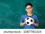 asian schoolboy holding... | Shutterstock . vector #1087781324
