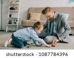 businessman in suit and little... | Shutterstock . vector #1087784396