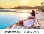 couple in hug watching sunrise... | Shutterstock . vector #108779978