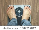 Stock photo male on the weight scale for check weight diet concept 1087799819