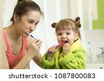 smiling mother and kid daughter ... | Shutterstock . vector #1087800083