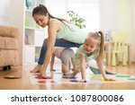 young mom playing twister game... | Shutterstock . vector #1087800086