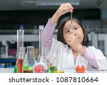 happy little scientist in lab... | Shutterstock . vector #1087810664