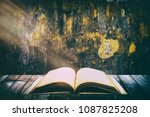 old vintage holy bible opened... | Shutterstock . vector #1087825208