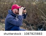 man with the binoculars against ... | Shutterstock . vector #1087825883