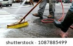 cleaning city streets with... | Shutterstock . vector #1087885499