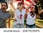 three young female friends with ... | Shutterstock . vector #1087925093