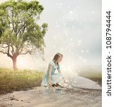 Young Blonde Girl at a Magical Brook - stock photo
