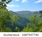 trees frame the view of the... | Shutterstock . vector #1087947740