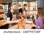 two handsome sellers in uniform ... | Shutterstock . vector #1087957289