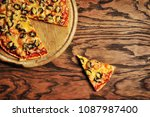 delicious pizza with a slice on ... | Shutterstock . vector #1087987400