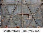 locked old rusty gates | Shutterstock . vector #1087989566