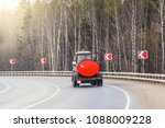 watering machine on the road at ... | Shutterstock . vector #1088009228
