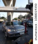 Small photo of Blurred a tow truck are towing brown vehicle are broken on the road to prevent the danger of accidental duplications and delivers to the garage