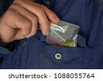 man hides a packet of spices in ... | Shutterstock . vector #1088055764