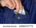 a man takes out a packet of... | Shutterstock . vector #1088055770