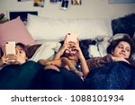 teenage girls using smartphones ... | Shutterstock . vector #1088101934