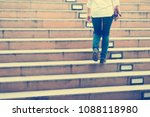 business woman stepping up the... | Shutterstock . vector #1088118980