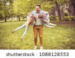 single father playing in park... | Shutterstock . vector #1088128553