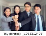 business people are joining... | Shutterstock . vector #1088212406