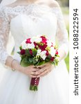 the bride in a white dress is... | Shutterstock . vector #1088222594