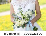 the bride in a white dress is... | Shutterstock . vector #1088222600