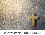 Small photo of Wooden Christian cross with concrete background. Wooden Christian cross background. Wooden Christian cross wallpaper. Christianity Concept. Faith hope love concept.