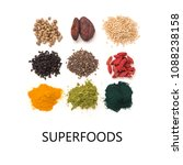 Small photo of Small heap of various superfoods isolated on white background. Superfood as chia, spirulina, matcha tea powder, raw cocoa bean, goji, hemp, quinoa, black sesame, turmeric. Copy space for text.Top view
