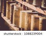 spinning buddhist prayer drums... | Shutterstock . vector #1088239004