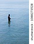 silhouette of a fisherman men... | Shutterstock . vector #1088273528