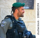 Small photo of JERUSALEM ISRAEL 28 10 2016: Portrait of Israel Defense Forces downtowm Jerusalem, commonly known in Israel by the Hebrew acronym Tzahal are the military forces of the State of Israel.