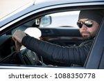 portrait of man in his car....   Shutterstock . vector #1088350778