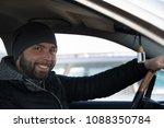 portrait of man in his car....   Shutterstock . vector #1088350784