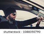 portrait of man in his car....   Shutterstock . vector #1088350790