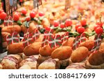spanish tapas called pintxos of ... | Shutterstock . vector #1088417699