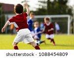 children playing soccer match.... | Shutterstock . vector #1088454809