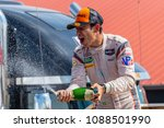 Small photo of May 06, 2018 - Lexington, Ohio, USA: Hello Castroneves (BRA) is showered with champagne from his fellow racers after winning the Acura Sports Car Challenge at Mid Ohio Sin Lexington, Ohio.