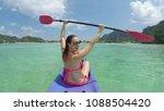 woman kayaking in turquoise...   Shutterstock . vector #1088504420