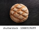 bread isolated on a dark marble ... | Shutterstock . vector #1088519699