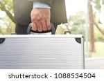 Small photo of Agent bank businessman is handle document briefcase bring on business solution job help client guarantee quality or professional salesman service client also mean messenger using for copy space
