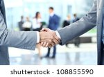 close up of businessmen shaking ... | Shutterstock . vector #108855590