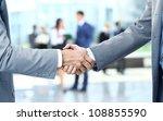 close up of businessmen shaking ... | Shutterstock . vector #108855590