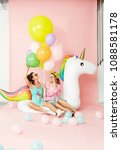 Small photo of Summer Fashion Girls Having Fun With Balloons On Unicorn Float