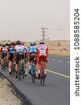Small photo of Ramat Negev, Israel - 06 May 2018: View from the back to the closing group of cyclists on the stage of Giro d'Italia from Beer Sheba to Eilat near the regional council Ramat Negev