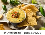 spicy homemade cheesey queso... | Shutterstock . vector #1088624279