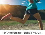 young woman running on trail | Shutterstock . vector #1088674724