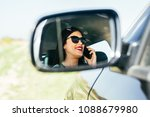 pose in the rear mirror of the... | Shutterstock . vector #1088679980